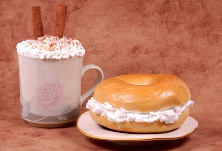 capuccino: Bagel and a Capuccino Stock Photo