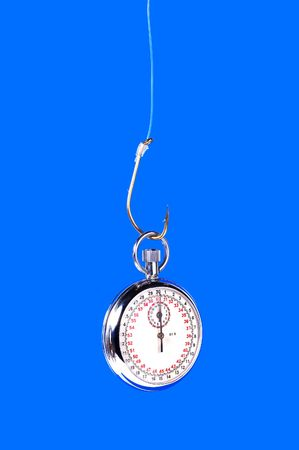 Stopwatch Hanging From a Hook Imagens