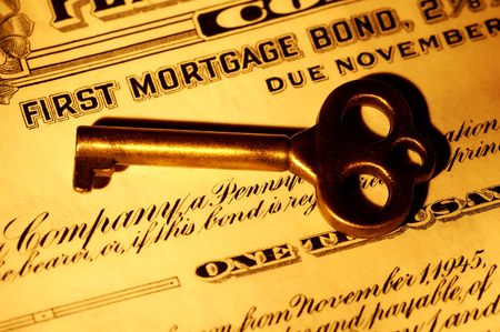 Skeleton key and a Mortgage Bond Certificate Stock Photo