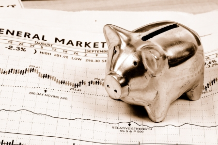 Photo of a Piggy Bank and Stock Chart