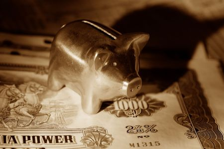 Photo of Stock Certificates and a Piggy Bank