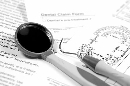 dental mirror: Dental Instruments and Claim Forms Stock Photo