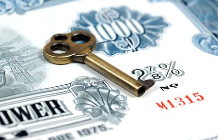Key and a Stock Certificate.  Key To Investing Concept Stok Fotoğraf