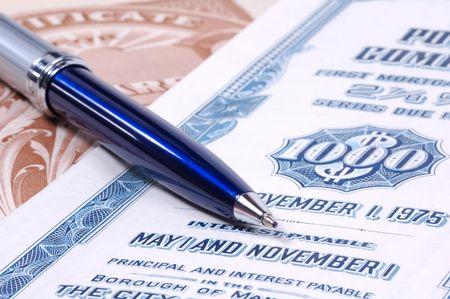 Ballpoint Pen and Stock Certificates