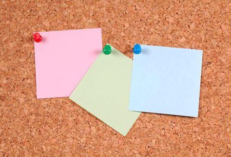corkboard: Postit Notes on a Corkboard Stock Photo