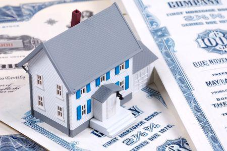 Miniature House on Mortgage Bonds Stock Photo - 292249
