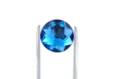 pinzas: Pinzas de fotos de la celebraci�n de una gema azul
