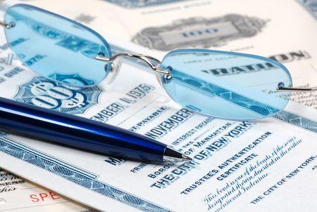 brokerage: Eyeglasses, Pen and Bond Certificates