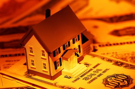 Miniature House And Mortgage Bonds With Creative Lighting photo