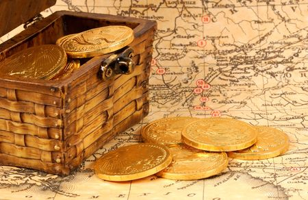 Treasure Chest With Gold Coins on a Map Imagens - 297611