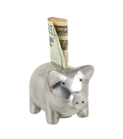 ira: Piggy Bank With Money Sticking Out Stock Photo