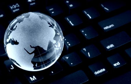 Glass Globe on a Keyboard Stock Photo - 299465
