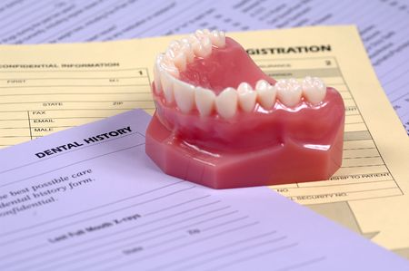 Dental History Forms and Model of Teeth Stock Photo