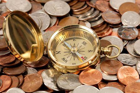 makelaardij: Foto van een kompas en Geld - Geld Concept