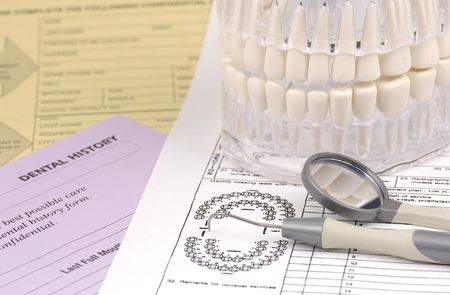gingivitis: Photo of Dental Forms and Various Dental Related Items Stock Photo