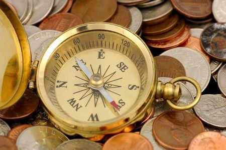 ira: Compass and Money -  Money Concept Stock Photo