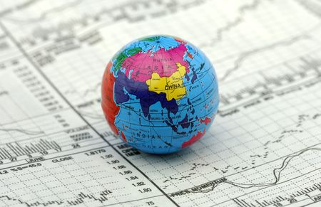 commodities: Global Markets Concept - Stock Charts and a Globe