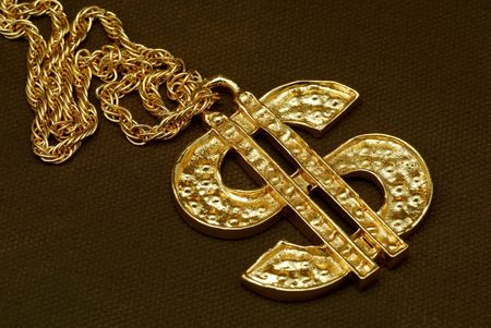 Gold Dollar Sign Necklace photo