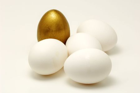 Photo of White Eggs and One Gold Egg