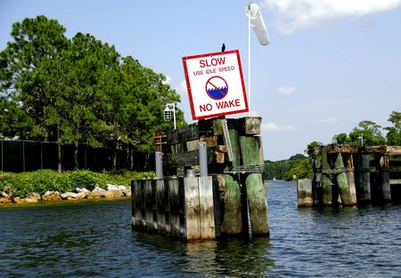 Photo of a No Wake Sign in a Channel Stock Photo - 415742