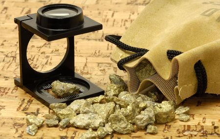 appraise: Loupe and Gold Nuggets Stock Photo