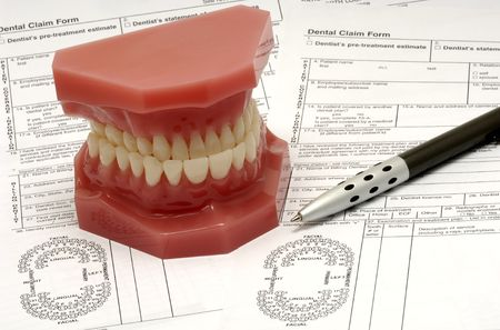 Dental Claim Forms and Model of Teeth Stock Photo