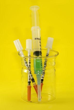 Beaker with Syringes Imagens