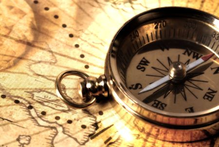 buccaneer: Brass Compass on a Map Stock Photo