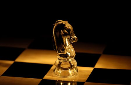 Photo of a Chess Board and Knight Stock Photo