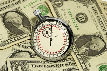Time is Money Concept - Stopwatch and Money photo