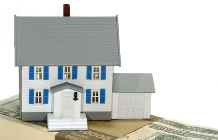 Miniature House on Top of Cash - Home Equity Concept Stock Photo - 516060