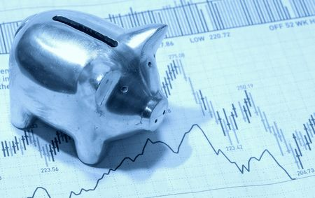 Photo of a Piggy Bank on Top of a Stock Chart in Cyan Tone  - Investment Concept