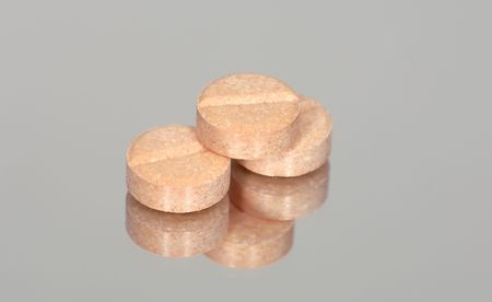 Photo of Pills on a Reflective Surface