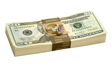 Photo of a Ring on top of a Stack of Cash