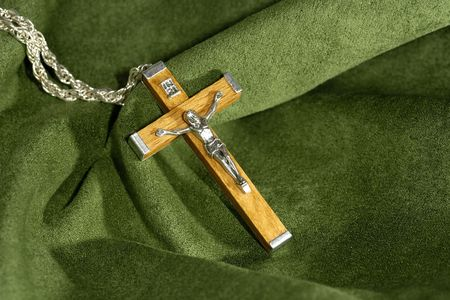 velvet background: Photo of a Wooden Crucifix on a Green Velvet Background Stock Photo