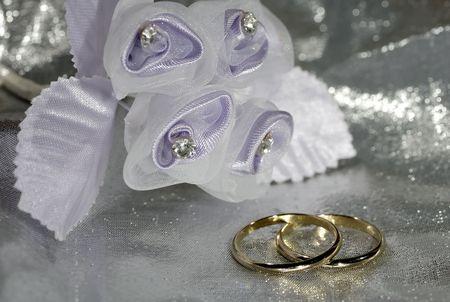 Photo of Wedding Bands on a Silver Fabric Reklamní fotografie