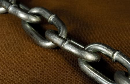 chainlinks: Photo of a Metal Chain on a Brown Background Stock Photo