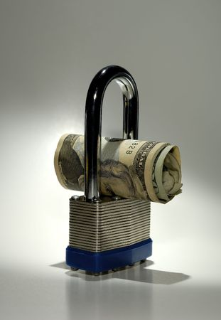 Foto de una cerradura y de un dinero - concepto de la seguridad financiera Foto de archivo - 564423