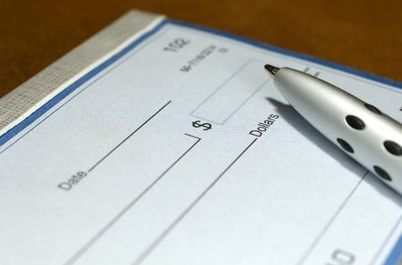 Photo of a Blank Check and a Pen