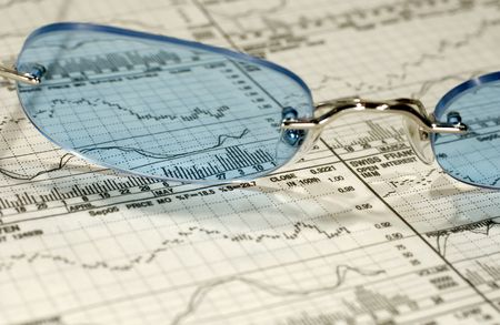 Photo of Eyeglasses on Top of Stock Charts - Investment Research Concept Stock fotó