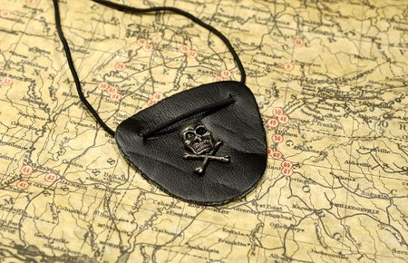 Photo of a Vintage Map and a Pirates Eye Patch Imagens