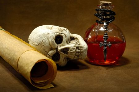 potion: Photo of Parchments, Skull and a Potion Bottle - Magic Spell Concept