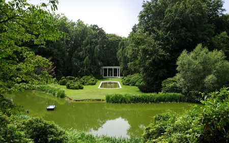 Photo of an Exotic Garden With a Pond, Pool and Greek Structures Stock Photo - 564562