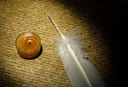 Photo of a Parchment With a candle and a Feather Stock Photo - 564556
