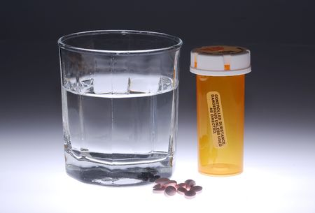 Photo of Medicine and a Glass Water