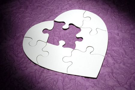 Photo of a Heart Shaped Puzzle Missing a Piece Stock Photo