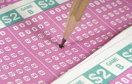 Photo of Lottery Forms and a Pencil - Gambling Concept Stock Photo
