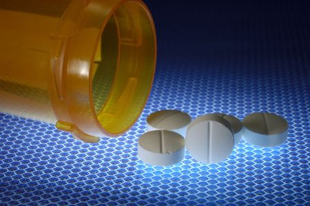 Photo of Pills and a Pill Bottle - Medical Concept Stock fotó