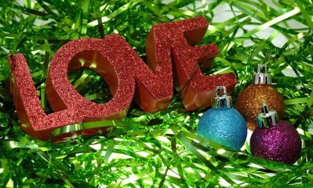 Photo of Green Tinsel and The Word Love With Red Glitter  -  Christmas Related