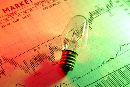 Photo of a Light BUlb on a Stock Chart With Gel Lighting - Investment Concept